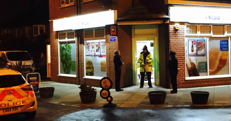 Man arrested after armed robbery on Timperley shop