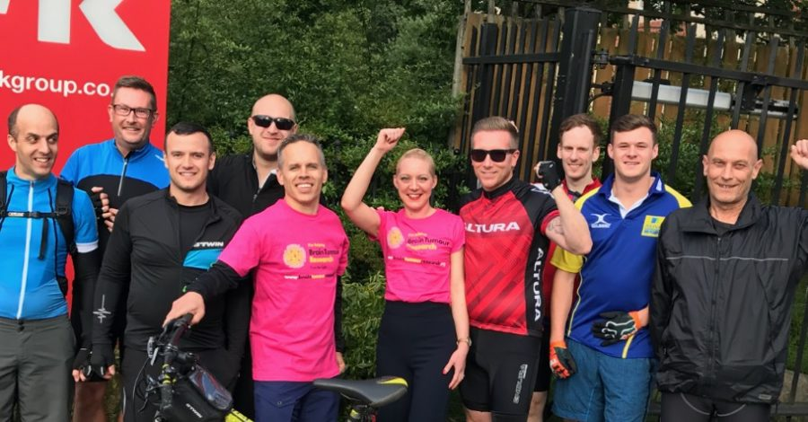 Altrincham staff complete 112-mile charity ride in support of colleague's wife