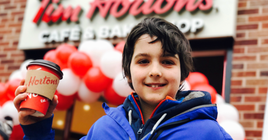 Oliver, 13, wins year's supply of coffee as he's first in the queue at opening of Tim Hortons' new Altrincham restaurant