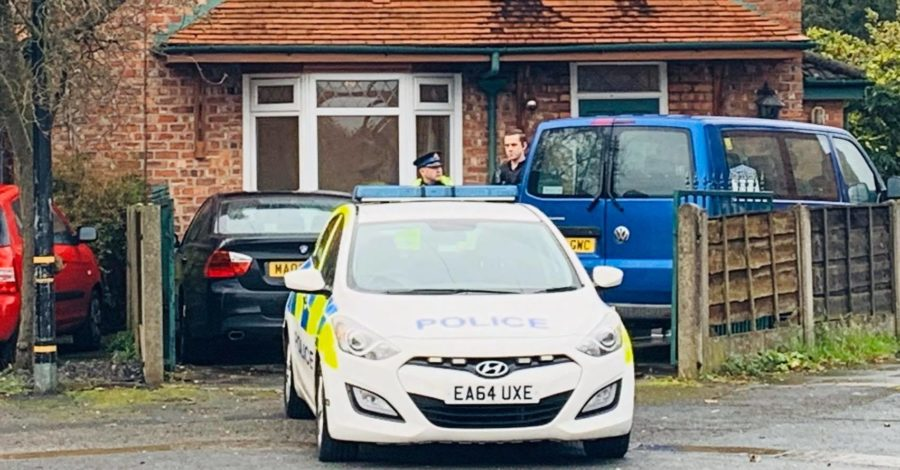 A man arrested after a woman was found dead at an Altrincham house has been released under investigation