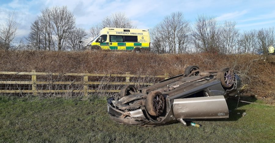 "Driver and passenger have ""very lucky escape"" after car lands upside down in a ditch close to Bowdon junction"